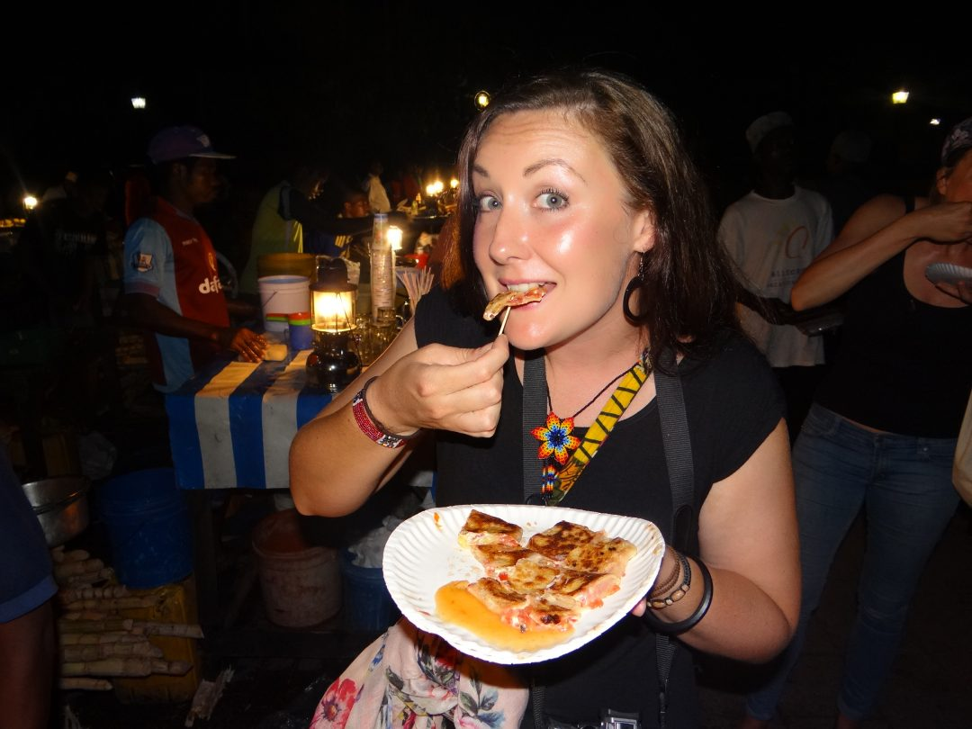 Eating a Zanzibar Pizza at Forodhani Gardens in Stone Town, Zanzibar.