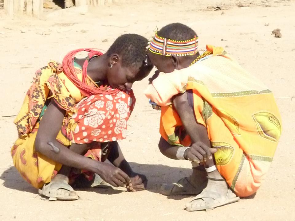 Two Women of the Samburu Tribe deep in conversation at Umoja Village, Kenya