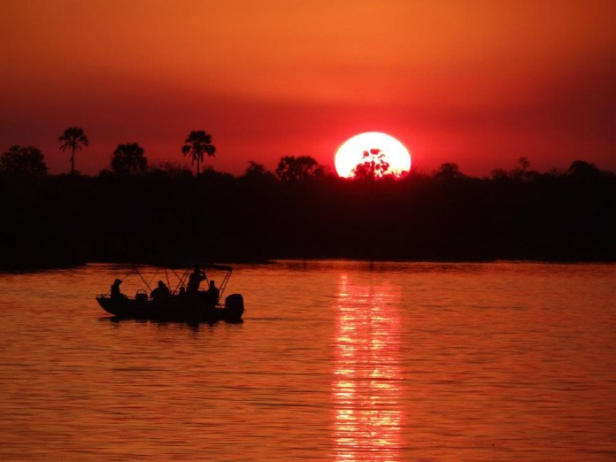 The Beginner's Guide to Backpacking East & Southern Africa - Sunset over the Zamzezi River