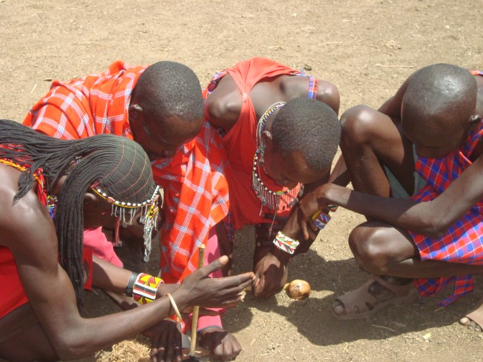 Maasai Lighting a Fire the Traditional Way
