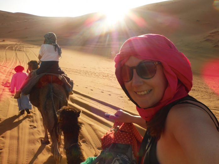 Camel riding in the Sahara Desert.