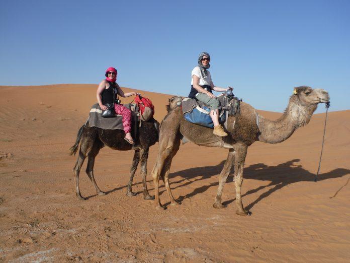 Camel ride in the Sahara Desert, Morocco.
